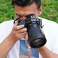 <b>行者橙子</b><em>旅行摄影师</em>
